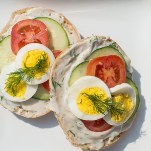 Bagel with Dill Cream Cheese, Tomato, Cucumber and Egg